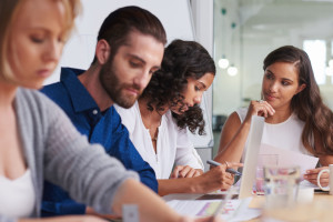 45972467 - coworkers meeting in boardroom to discuss ideas for company productivity at work